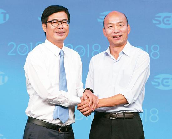 高雄市長選舉辯論會,兩黨候選人韓國瑜(右)與陳其邁(左)先禮後兵,激烈交鋒。 圖/三立提供